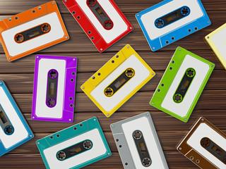 Multi-colored retro audio cassettes on wooden table. 3D illustration
