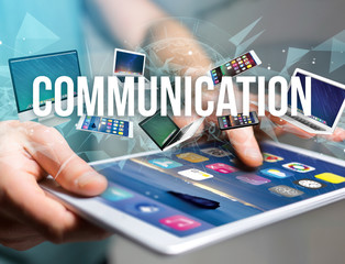 Communication title surounded by device like smartphone, tablet or laptop - Internet and communication concept