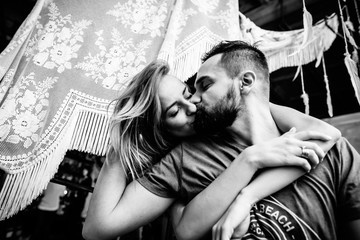 Couple kissing and hugging each other. Black and white photo. View side
