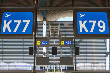 Departure gate information signal at airport terminal. Travel background