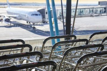 Trolleys at international airport. Runaway and finger. Travel background