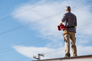 Electrician standing on rooftop