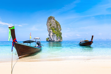 Pristine beach turquoise water longtail boats, Krabi, Thailand travel destination