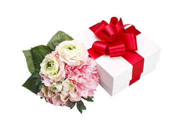Gift box with red ribbon and bouquet