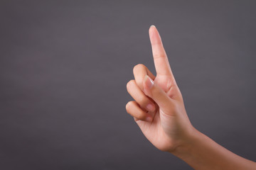 hand pointing 1 finger up, number one victory gesture