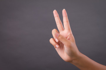 hand pointing 2 finger up, number two victory gesture