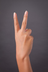 hand showing rude v sign