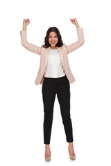 excited young business woman with hands up and fists closed