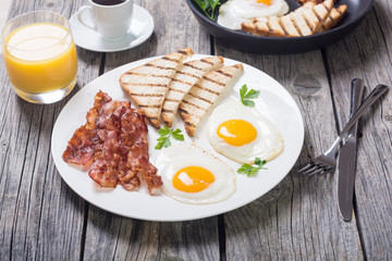 Breakfast with eggs bacon and toasts