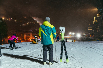 man standing on the top of snowed hill ready for ski