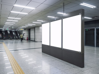 Mock up Blank Banners in Subway station with blurred people Travel