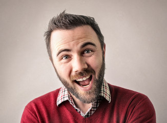 Cheerful man being surprised by something