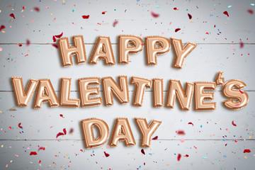 """Luftballons formen die Nachricht """"Happy Valentine's Day"""" auf Holzuntergrund mit Konfetti"""