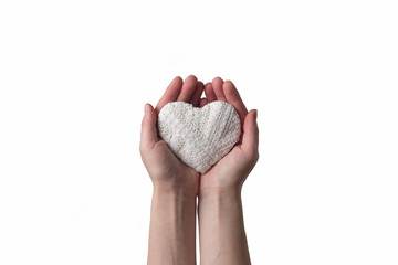 Female hands holding a white heart isolated on white background