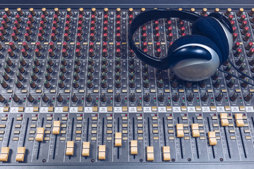headphone on sound mixer, music background