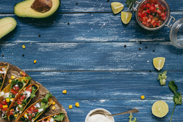 Mexican tacos with salsa and avocado on the wooden blue background, top view Wall mural