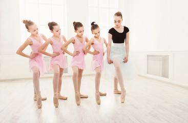 Teacher helping her students during dance class