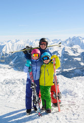 Happy family enjoying winter vacations in mountains . Ski, Sun,Snow and fun.