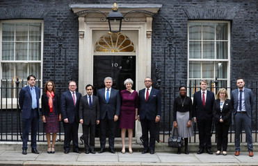 Britain's Prime Minister Theresa May poses with Brandon Lewis and James Cleverly and other members of their teams outside 10 Downing Street, London