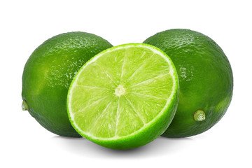 two whole fresh green lime with half isolated on white background