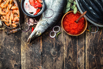 Fototapete - Different seafood with shrimps and red caviar.