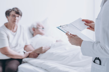 Doctor reading report to patient