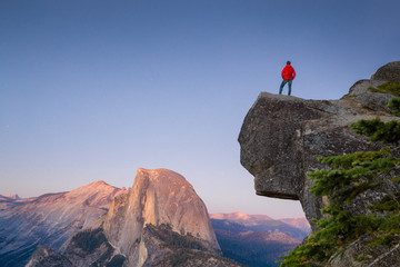 Hiker in Yosemite National Park at sunset, California, USA