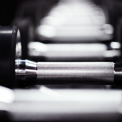 Dumbbell in gym. Sport concept. Close-up macro photo.