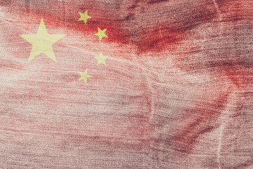 China flag on denim material in vintage style.