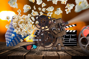 Pop-corn, movie tickets, clapperboard and other things in motion.