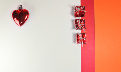Red valentine or christmas heart with gift box on white background, minimalist concept