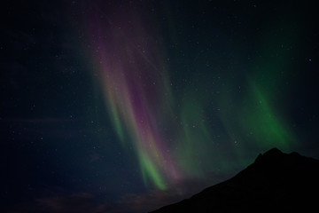 Aurora Borealis over a Mountain in Iceland