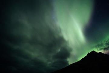 Aurora Borealis over a Mountain in Iceland