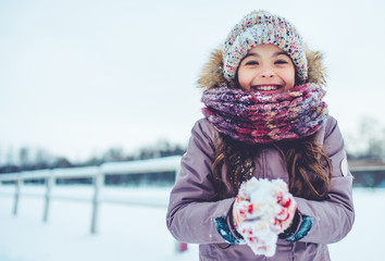 Little girl outdoor in winter Wall mural