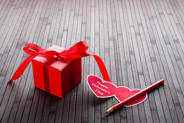 Heart-shaped Valentine's day greeting card and red present box
