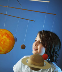 Kids and Science, self made Solar System Project - Studio shots with Young happy Boy