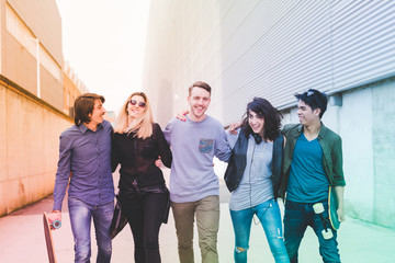 Group of friends millennials walking arm aroung outdoor having fun - friendship, interacyion, happiness concept