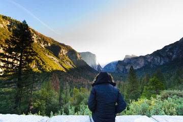 A man sitting in yosemite national park California