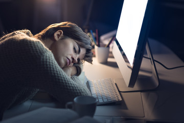 Tired woman sleeping on the desk
