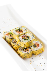 Tempura maki sushi - deep fried hot sushi roll with salmon, tuna, eel, chukka and sesame