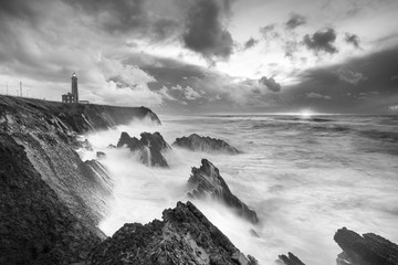 Dramatic sky, lighthouse and the Storm