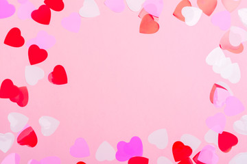 Decorative hearts confetti on pink background