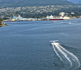 Seaplane takeoff on Burrard Inlet, Vancouver, Canada