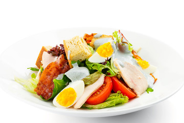 Fresh green salad with chicken, bacon, eggs, tomatoes and croutons