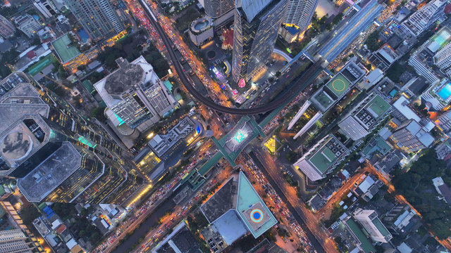 Top view city , Aerial view road , Expressway with car lots in the city in Thailand. Beautiful Street at downtown.Road roundabout