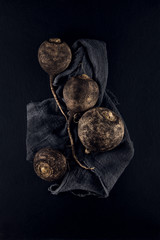 fresh black radish decorated on slate plate kitchen table can be used as background
