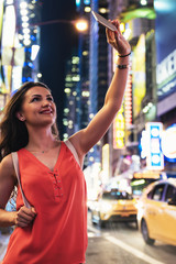 Beautiful woman using phone in Times Square.