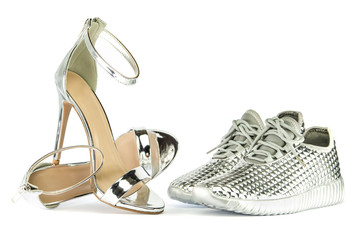 Stiletto high heels and sneakers in metallic silver