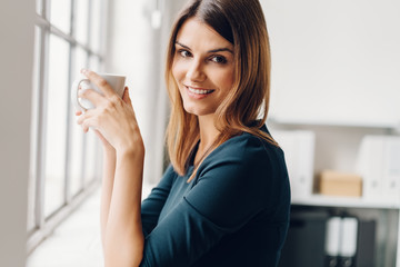 Attractive woman enjoying a cup of coffee