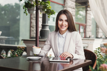Young businesswoman outdoors working with laptop